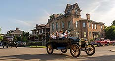 Photo: Model T-s parade down North 10th Street in Richmond, Indiana.