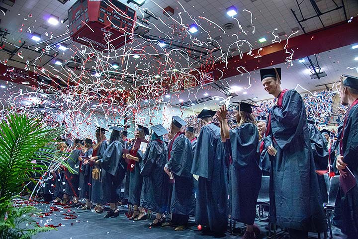Supplied Photo: Graduates in gowns and caps with lots of confetti.