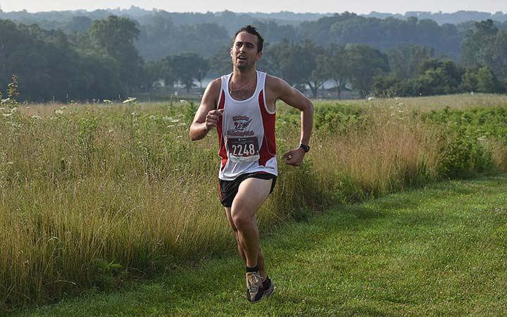 Supplied Photo: Adam Mengel participates in IU East's Run with the Wolves 5K on July 20. He was the overall winner of the race. Mengel is the head coach of IU East's cross country teams.