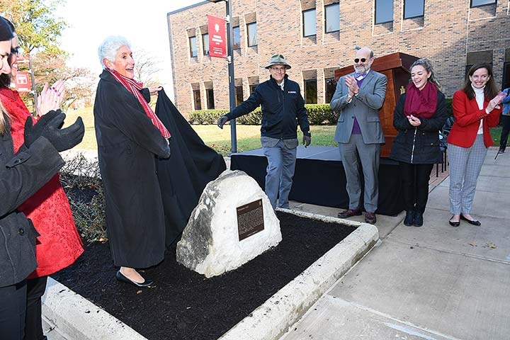 Supplied Photo: IU East Chancellor Kathy Cruz-Uribe unveils the IU Bicentennial Marker during the dedication ceremony held November 5 in front of Whitewater Hall.
